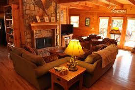 living room inspiration astounding rustic orange living room in log cabin interior decor as well as stone wall exposed around vintage fireplace and brown