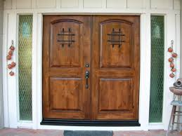 exterior brown wooden double entry doors with black metal handle connected by double glass window