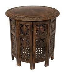 small ornate wooden round accent table