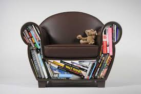 cute small leather kids chair with dark brown color and bookshelf storage with pillow and dool for small spaces ideas