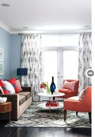 dark brown couch with grey blue wall and navy accents coral and navy living room blue walls brown furniture