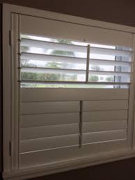 custom wood plantation shutters with split tilt bar standard trim and sill caps custom