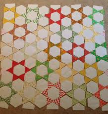 Easy Hexagon Star Quilt | Calvin & Carolyn & Now comes the fun part, construction. This quilt is worked in columns (or  rows depending on how you look at it), and can easily be chain pieced. Adamdwight.com