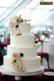 Gorgeous Textured Buttercream Wedding Cake Adorned With Fresh