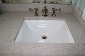 quartz countertop with single basin undermount sink in bathroom