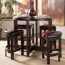 5 pieces pub style dining sets design with round wooden dining table and triple leg stools with leather seats for small dining room spaces ideas
