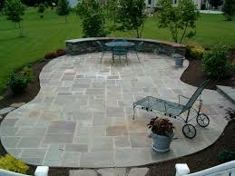 transform your backyard with these awesome and relaxing stone patio designs