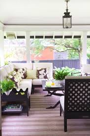 covered patio freedom properties: covered porch with black amp white furniture striped rug and outdoor pendant light anne
