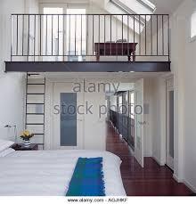 Bedroom with overlooking mezzanine - Stock Image