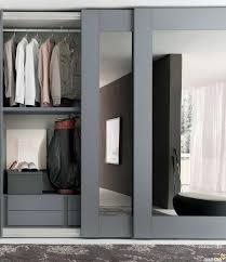 retractable cabinet doors create a new look for your room with these closet door ideas