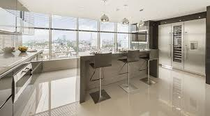 the designer kitchen of a large penthouse apartment featuring 90x90cm china clay porcelthin mono porcelain floor tiles t66