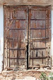 a very old double door from an indian village samode india stock photo