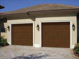 these clopay gallery collection grooved panel steel garage doors have a simulated stained wood appearance but