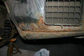 Rust under the front light (right side). Peeling The W210 Rust Onion Mercedes Benz Forum
