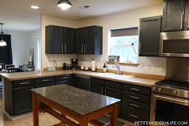 see what we learned of cleaning priming and painting our kitchen cabinets in part 2