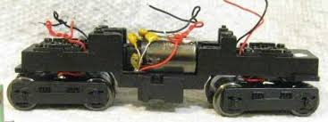 caps on motor cropped jpg the capacitors are the yellow devices on the motor