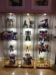 Ikea Detolf display cases - Very cool having three side-by-side for a  really clean and professional display of a high-end collection.