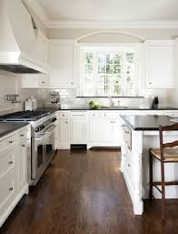 white cabinets dark floors. love the dark wood, white cabinets, and grey tile. a little color in cabinets floors e