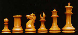 Original Staunton Chess Pieces, Left To Right: Pawn, Rook, Knight, Bishop,  Queen, And King