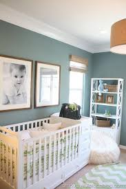 Great color scheme for a boy's nursery - wall color, burlap lam shade, wood  details, and white molding.