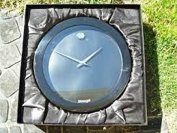 movado wall clock in black off 60
