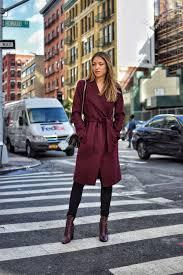 winter new york city street style in a burdy wool coat black jeans burdy
