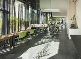 office space architecture. Dutch Creative Communication Firm, Heldergroen Has Turned Its Offices Into A Streamlined Workplace Flooded With Natural Light, As Well Kind Of Business Office Space Architecture