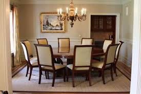 classic dining room design with 72 inch round pedestal dining table antique brass chandelier lighting