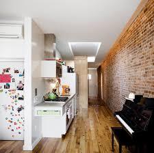 compact apartment furniture. Kitchen, White Cabinet, Medium Hardwood Floor, Accent Lighting, Range Hood, Undermount Compact Apartment Furniture