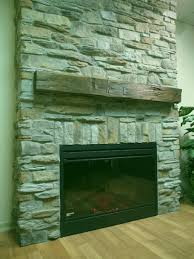 stone extends floor to ceiling slightly offset from surrounding wall simple rustic beam shelf mantle
