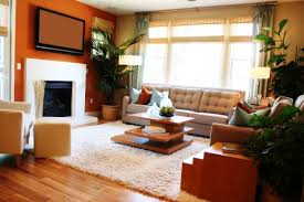 living room with a large rug in the center of the room beneath an artisan coffee