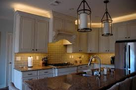over cabinet lighting for kitchens. white wooden traditional kitchen with led lcabinte lighting above and under the cabinet over for kitchens o