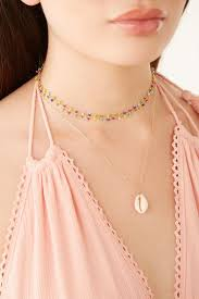 cowrie shell pendant necklace lyst view fullscreen