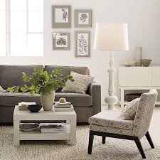 living room floor lamp. elegant and classy white floor lamp create exciting living room grey sofa fur rug small coffee table vas picture frames with desk