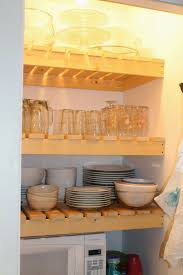 diy wood slat pantry shelves with dishes, Girl Meets Carpenter on  @Remodelaholic