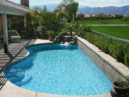 small backyard pools | Small backyard pool with rock fountain