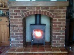 clearview pioneer multifuel stove in brick arch fireplace wood burning