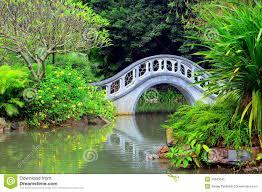 Zen Gardens Grasses Stone Bridge And Water Pond In Japanese Zen Garden Stock