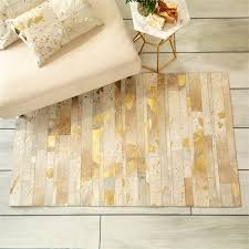 gorgeous gold area rugs golden natural cowhide area rug in metallic gold luxury home