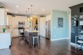 Fischer Homes Design Center Cincinnati Brown Center Island With White Cabinets And Mint Wall Color