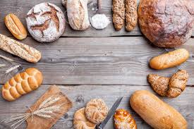 Delicious Freshly Baked Bread On Wooden Background Stock Photo