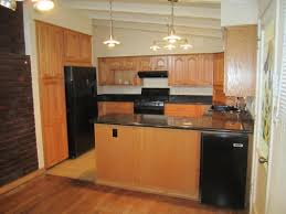 Kitchens With Black Appliances Black Kitchen Appliances With Oak Cabinets Outofhome