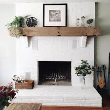It only took a few years to convince @timbfair to paint our fireplace brick  white