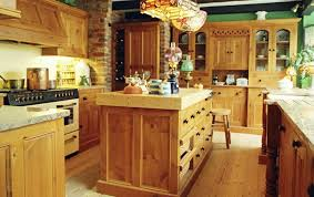 warm kitchen with unfinished pine cabinets