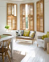 Living Room:Striking Living Room With Rattan Bench In Front Of Wooden Bay  Windows Striking
