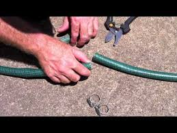garden hose repair tape.  Tape Repairing A Garden Hose On Repair Tape