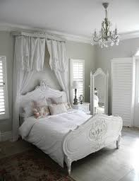 White in White Shabby Chic Bedroom with a Canopy over Headboard