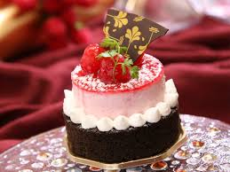 Chocolate Cake With White Icing And Strawberry On Top With Chocolate