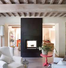 Una chimenea abierta por ambos lados es excelente para separar ambientes.  Adems el tono negro. Family RoomsLoftsWarmOpen FireplacePull ...