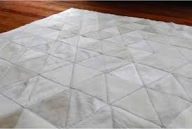 close up of white cowhide patchwork rug in triangles design
